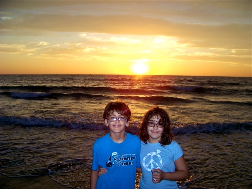 Classic!  Photo of your kids in front of a sunset so beautiful it looks fake.